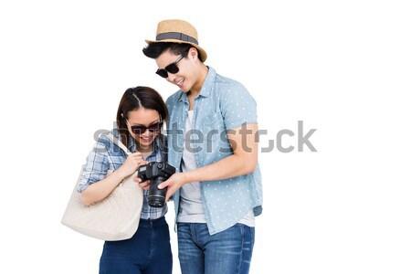 Happy young couple looking in camera Stock photo © wavebreak_media