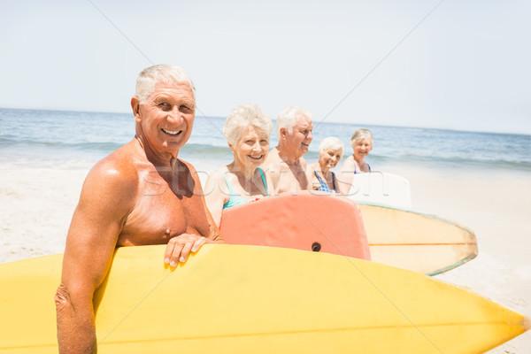 Senior friends holding surfboard Stock photo © wavebreak_media