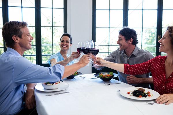 счастливым друзей рюмку обед ресторан Сток-фото © wavebreak_media