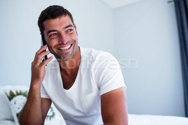Feliz homem falante telefone quarto casa Foto stock © wavebreak_media