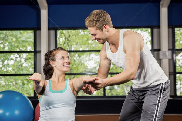 Trainer assisting woman with abdominal crunches Stock photo © wavebreak_media