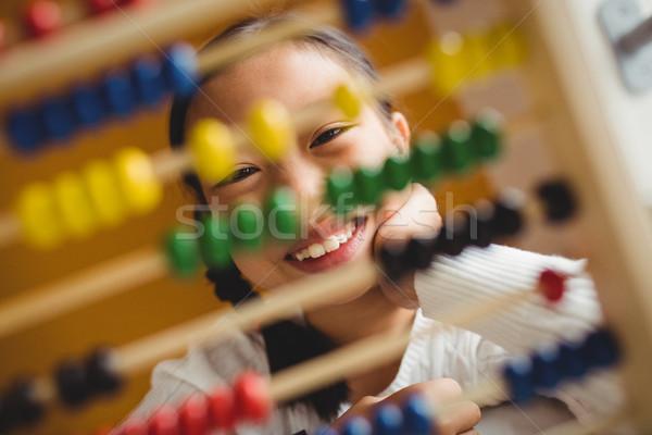 Schoolchild using a slide rule Stock photo © wavebreak_media