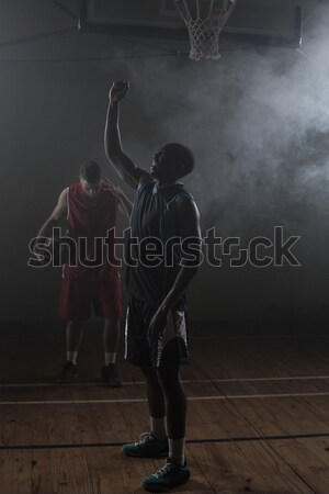 Victorious basketball player raising his arms up Stock photo © wavebreak_media