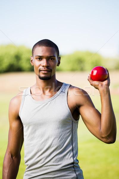 Male athlete holding shot put ball Stock photo © wavebreak_media
