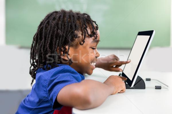 Boy using digital tablet in classroom Stock photo © wavebreak_media