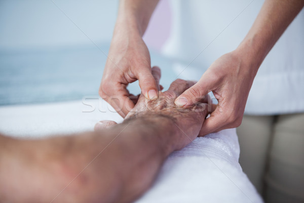 Physiotherapist giving hand massage to a patient Stock photo © wavebreak_media