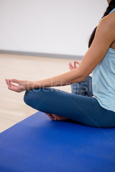 Woman sitting in lotus pose Stock photo © wavebreak_media