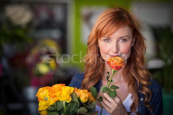 Portrait of female florist holding bunch of flowers Stock photo © wavebreak_media