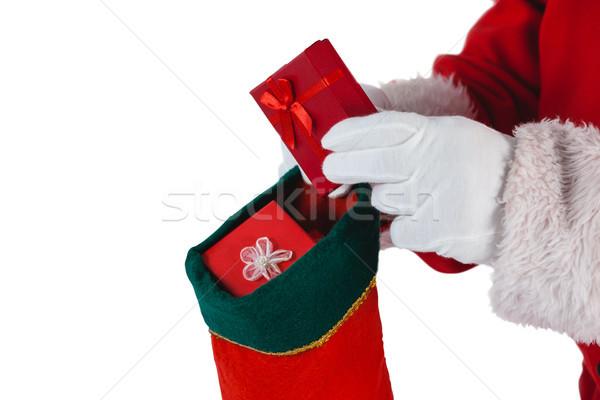 Papai noel presentes natal meias branco Foto stock © wavebreak_media