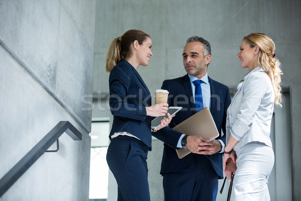 Business colleagues interacting with each other Stock photo © wavebreak_media