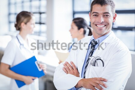Doctor and nurse discussing over a report Stock photo © wavebreak_media