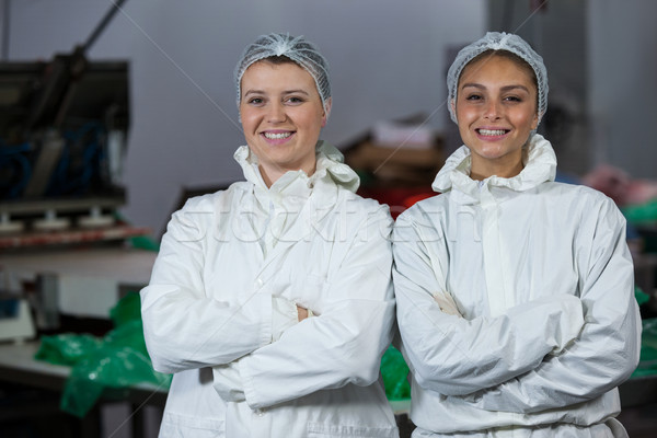 Female butchers standing with arms crossed Stock photo © wavebreak_media
