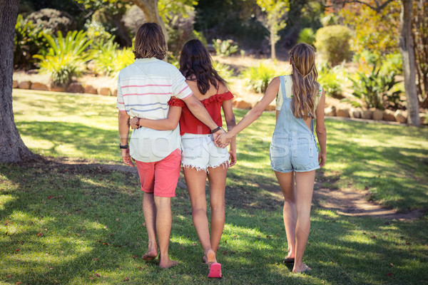 Man cheating on her woman in park Stock photo © wavebreak_media