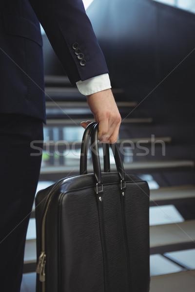 бизнесмен портфель низкий служба Сток-фото © wavebreak_media