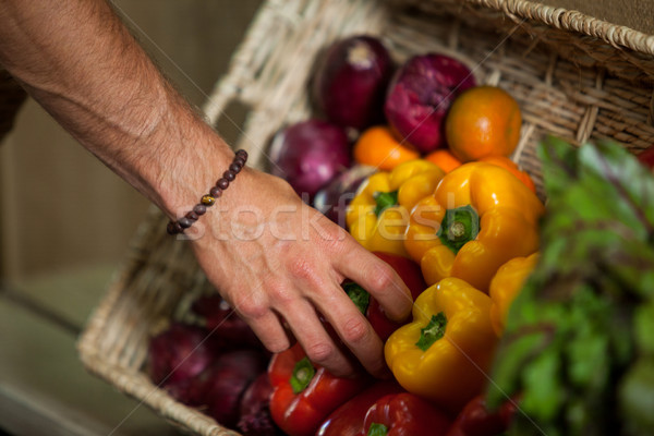 Hand of male staff selecting bell pepper in organic section Stock photo © wavebreak_media