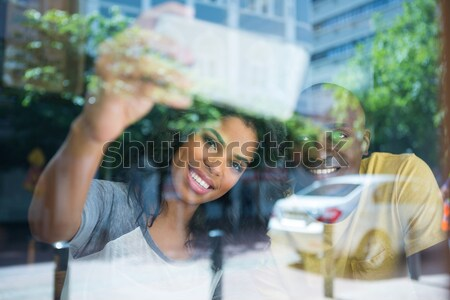 Couple taking selfie in coffee shop seen through window Stock photo © wavebreak_media