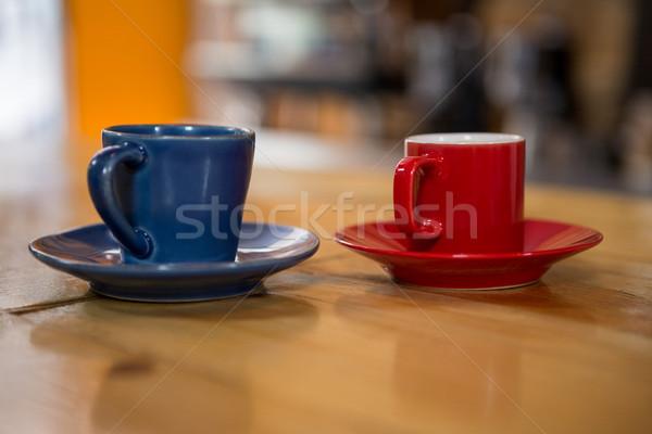 Kávéscsészék fa asztal büfé üzlet étterem kék Stock fotó © wavebreak_media
