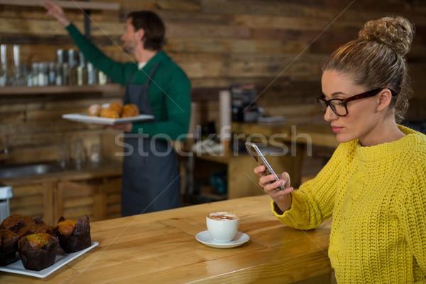 女性 携帯電話 コーヒーショップ 男 電話 肉 ストックフォト © wavebreak_media