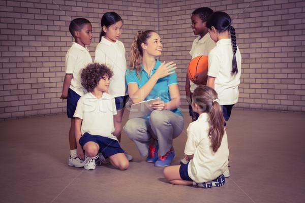 Lehrer sprechen Sport Studenten Frau Mädchen Stock foto © wavebreak_media