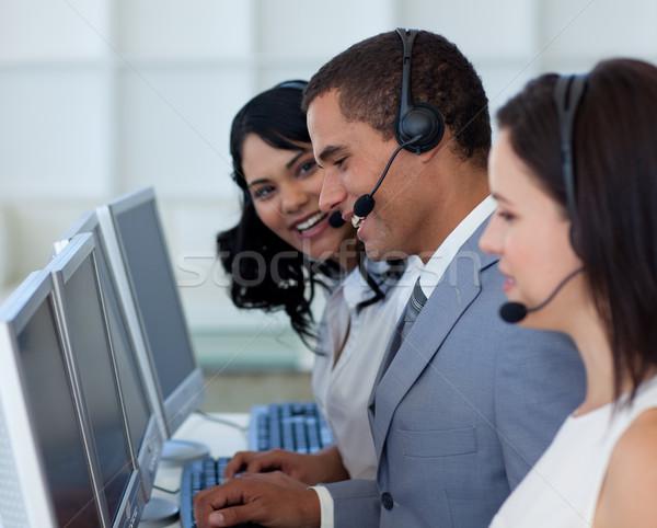 Hansome businessman in a call canter  Stock photo © wavebreak_media