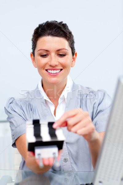 Morena empresária consultor cartão de visita escritório livro Foto stock © wavebreak_media