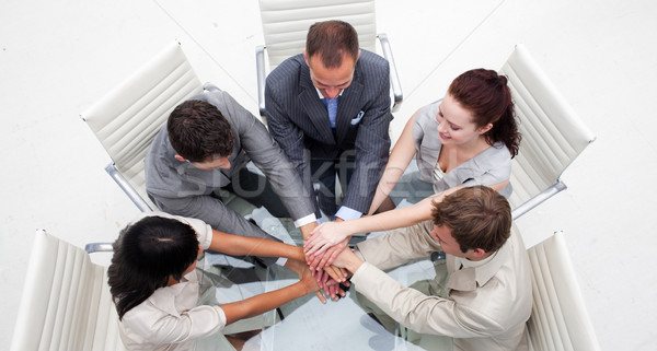 High angle of business people with hands together Stock photo © wavebreak_media