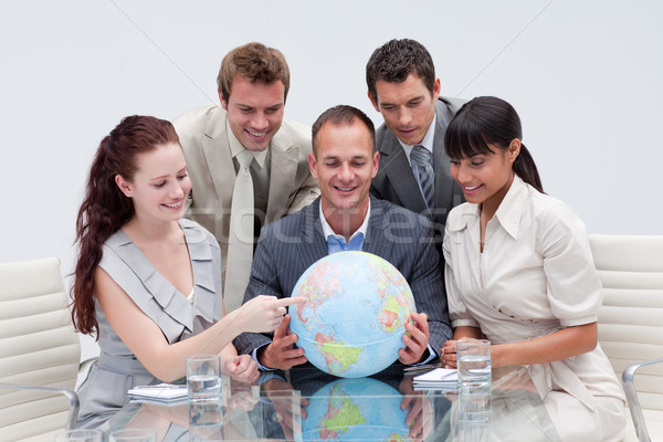 Business team holding a terrestrial globe. International busines Stock photo © wavebreak_media