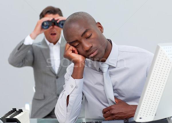 Empresário irritado homem olhando binóculo escritório Foto stock © wavebreak_media