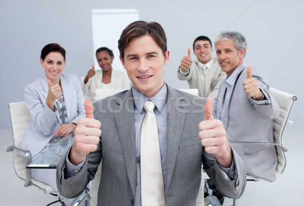 Attractive businessman celebrating a sucess with his team Stock photo © wavebreak_media