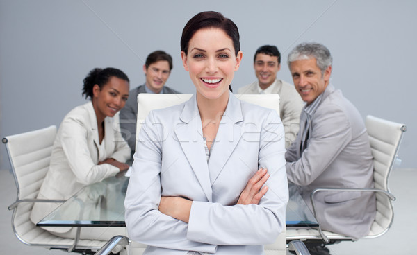 Heureux femme d'affaires souriant réunion collègues travail Photo stock © wavebreak_media