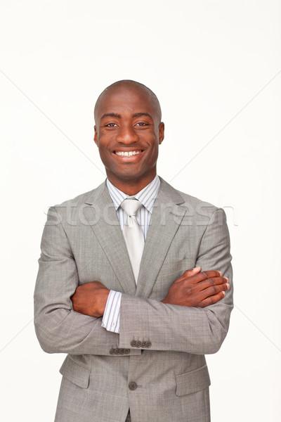 Sonriendo empresario doblado armas blanco negocios Foto stock © wavebreak_media