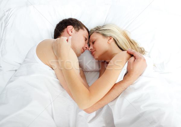 Amigo mirando compañera dormir cama mujer Foto stock © wavebreak_media
