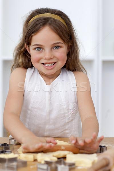 Smiling little girl baking in the kitchen Stock photo © wavebreak_media