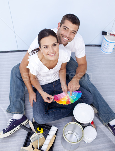 High angle of couple chosing colours to paint new house Stock photo © wavebreak_media