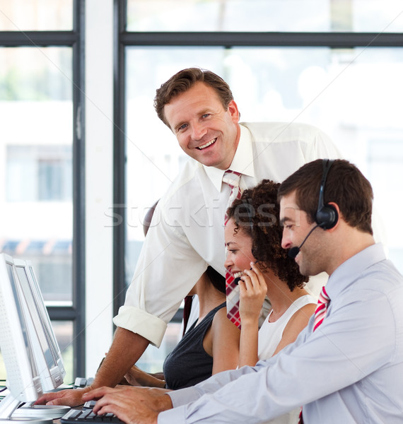 Mature manager in a call center smiling at the camera Stock photo © wavebreak_media