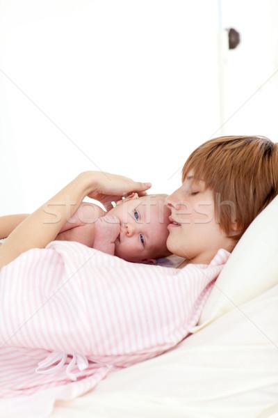 Patient relaxing with her newborn baby in bed Stock photo © wavebreak_media