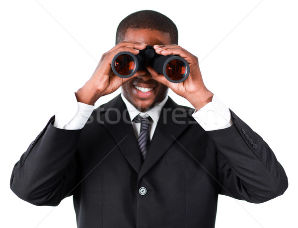 Close-up of an smiling businessman looking through binoculars Stock photo © wavebreak_media