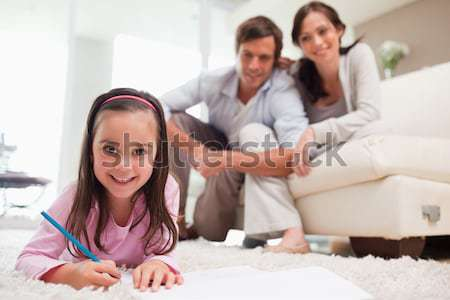 Family decorating their new home Stock photo © wavebreak_media