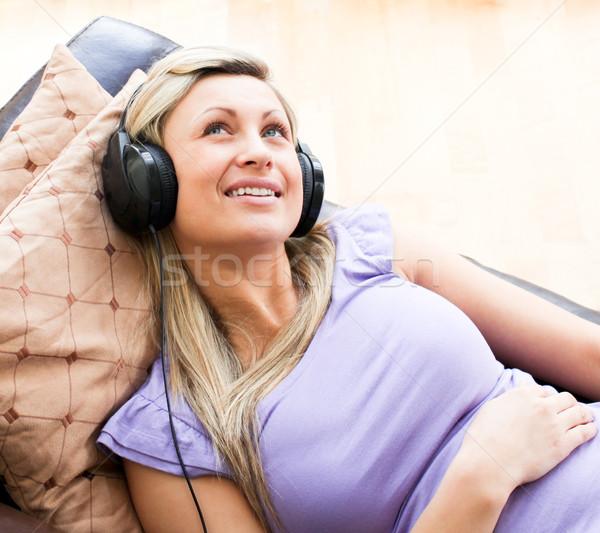 Blijde vrouw hoofdtelefoon sofa gelukkig rock Stockfoto © wavebreak_media