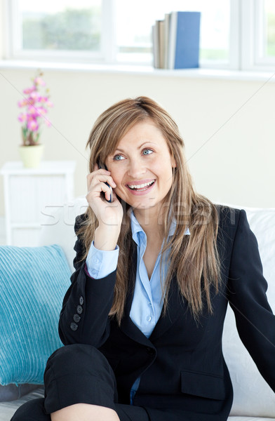 Radiant woman on phone sitting on a sofa in the office Stock photo © wavebreak_media