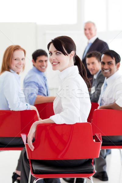 Vonzó kaukázusi üzletasszony konferencia mosolyog kamera Stock fotó © wavebreak_media