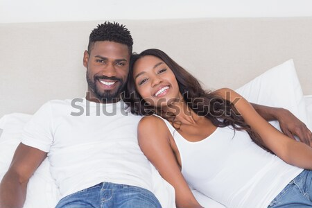 Affectionate couple embracing on their bed Stock photo © wavebreak_media