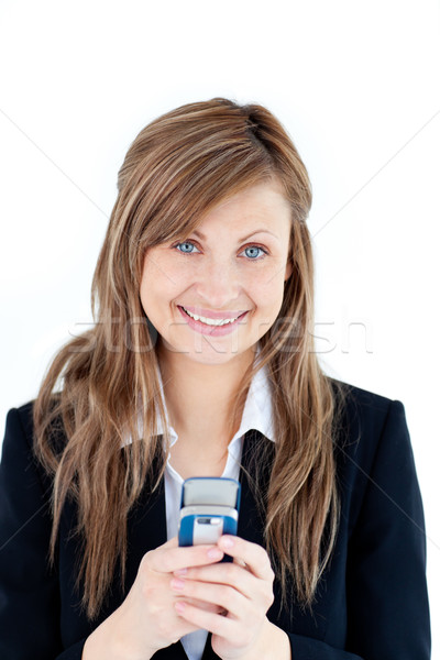 Radiant businesswoman writing a message with her cellphone against white background Stock photo © wavebreak_media