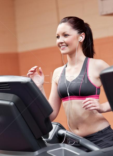 улыбаясь спортивный женщину подготовки работает машина Сток-фото © wavebreak_media