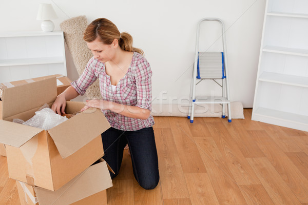 Blond-haired woman preparing to move house  Stock photo © wavebreak_media