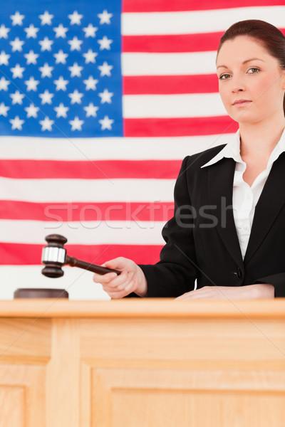 Portrait sérieux juge marteau drapeau américain main Photo stock © wavebreak_media