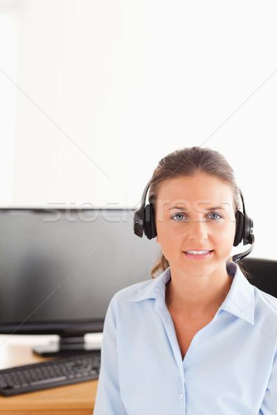 Secretario auricular posando ordenador oficina Foto stock © wavebreak_media