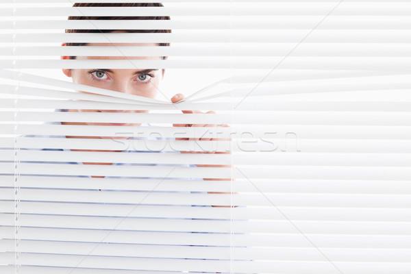 Kíváncsi aranyos nő ki ablak iroda Stock fotó © wavebreak_media