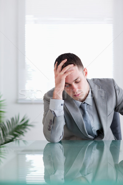 Close up of businessman that got bad news sitting behind a table Stock photo © wavebreak_media