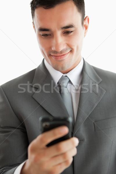 Közelkép üzletember ír szöveges üzenet telefon fehér Stock fotó © wavebreak_media